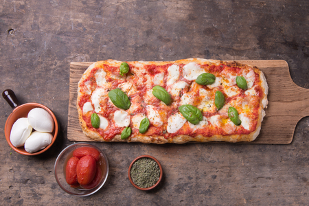 Foto de Pala romana's pizza on top view rustic still life composition - Imagen libre de derechos
