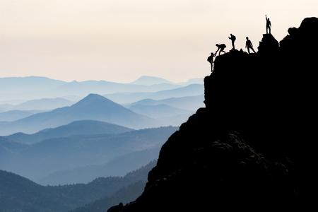 Foto de rock climbing & mountaineering & mountain climber help - Imagen libre de derechos