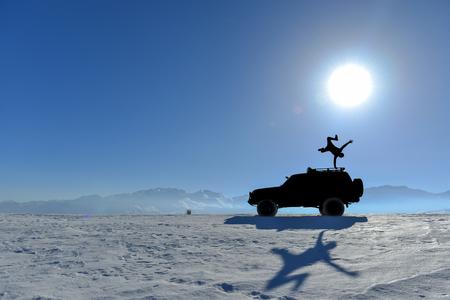 Photo pour Access to tough mountains with land vehicle and the joy of success - image libre de droit