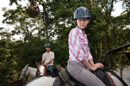 Equestrian couple posing on a horse ranch in Costa Rica