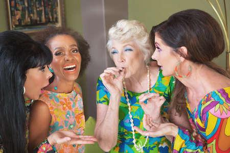 Photo pour Laughing group of women smoking a joint - image libre de droit