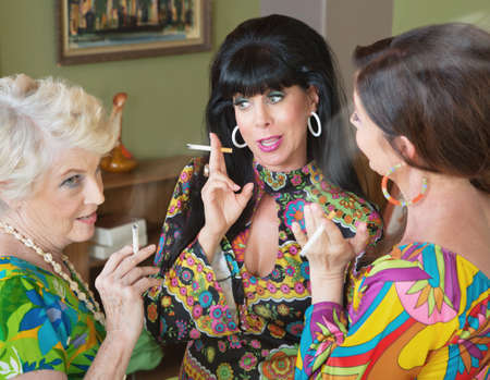 Photo for Group of three 1960s style women gossiping and smoking - Royalty Free Image