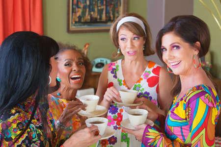 Photo pour Cute group of retro style women drinking tea - image libre de droit