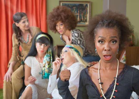 Photo pour Black woman surprised with group of adults smoking pot - image libre de droit