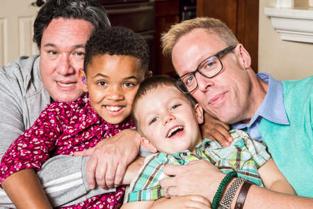 Photo for Gay parents and their children pose for a photo - Royalty Free Image