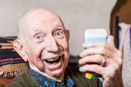 Photo for Older gentleman taking a selfie with smartphone - Royalty Free Image