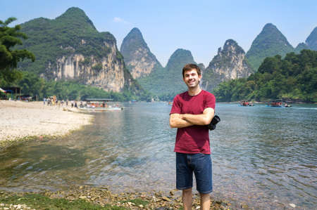Photo for Happy tourist by the Li river in Yangshuo, China - Royalty Free Image