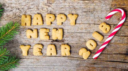 Photo pour Happy new year note written with cookie letters - image libre de droit