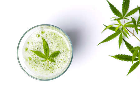Foto de Green marijuana smoothie juice on white background - Imagen libre de derechos