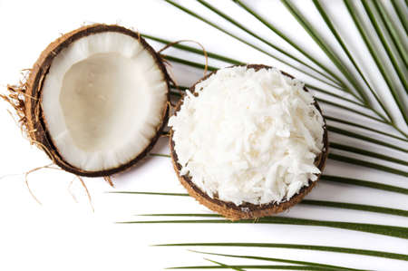 Photo for Grated coconut in a natural shell as bowl - Royalty Free Image