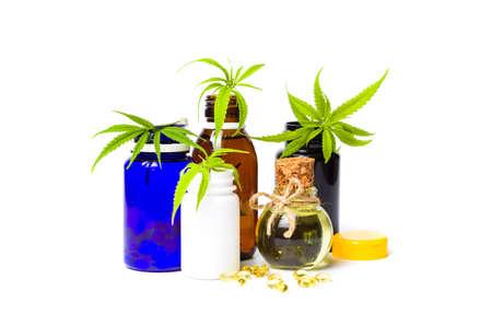 Foto de Marijuana oil bottles and leafs isolated on white - Imagen libre de derechos