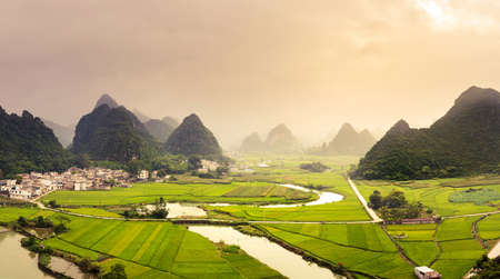 Photo for Stunning rice fields and karst formations scenery in Guangxi province of China - Royalty Free Image