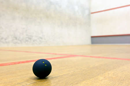 Squash ball in sport court