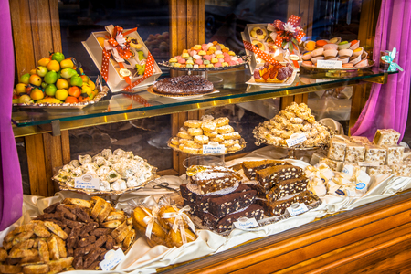 Photo for Traditional Italian Pastry shop glass display with selection of nougat, cookies, cake and sweets - Royalty Free Image