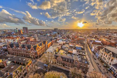 Foto de Helicopter View over historic part of Groningen city under setting sun - Imagen libre de derechos