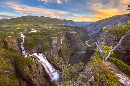 Photo for Famous Voringfossen gorge with waterfall near Eidfjord in province of Hordaland Norway - Royalty Free Image