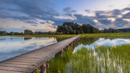 Photo for Long exposure image of wooden footbridge as a concept for challenge in nature reserve de Blauwe Kamer near Wageningen, Betuwe, Netherlands - Royalty Free Image