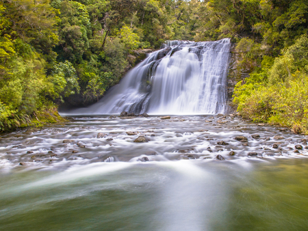 Photo for Long exposure image of a waterfall in lush rainforest of Te Urewera National Park in New Zealand - Royalty Free Image