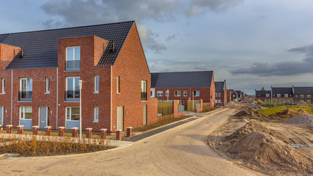 Foto de Newly built houses in modern street building site in suburb of city in the Netherlands - Imagen libre de derechos