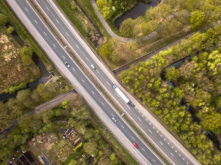 Photo for Aerial view of four lane motorway with emergency lane and moderate traffic during rush hour - Royalty Free Image