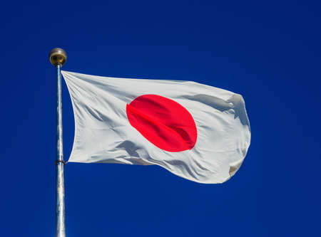 Photo for National Flag of Japan with the Red Sun waving in the wind - Royalty Free Image