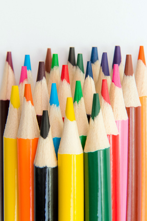Photo for An assortment of colour pencils on white background. School supplies, creativity concept - Royalty Free Image