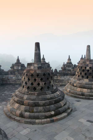 Photo pour Borobudur Temple with the mysteries forest surrounding at dawn, Yogyakarta, Indonesia - image libre de droit