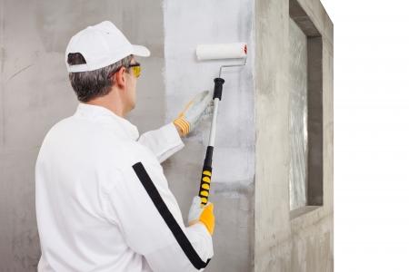 Foto de Worker priming with a paint roller - Imagen libre de derechos