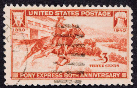Foto de USA - Circa 1940:A Cancelled postage stamp from the USA illustrating Pony Express Anniversary, issued in 1940. - Imagen libre de derechos