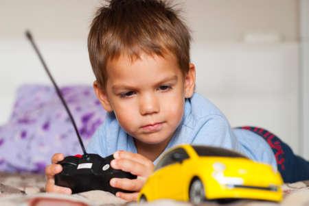 Foto de little boy and car on the radio control - Imagen libre de derechos