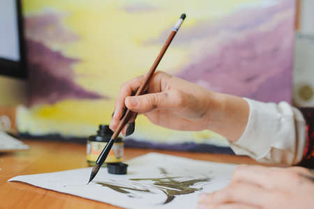 Photo for Female artist paint hand writing chinese calligraphy - Royalty Free Image