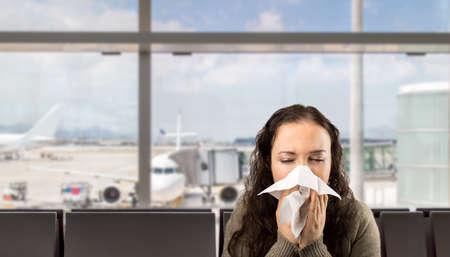Foto de sneezing woman sick blowing nose with white background - Imagen libre de derechos