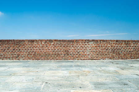 brick wall with blue sky background