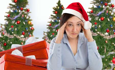 Foto de Stressed woman shopping for gifts of christmas with red santa hat looking angry and distressed - Imagen libre de derechos