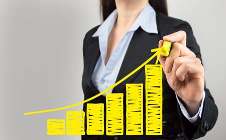 Photo pour cropped shot of a businesswoman drawing a growth chart of the benefits - image libre de droit