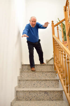 Foto de senior man falling down on the stairs at the home - Imagen libre de derechos