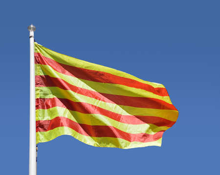 Foto de Close-up of catalan senyera flag with blue sky - Imagen libre de derechos
