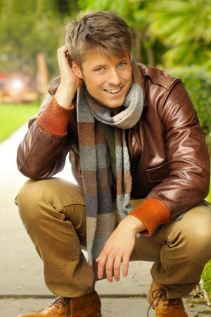 Photo for Young handsome man with nice smile in casual clothing outdoors - Royalty Free Image