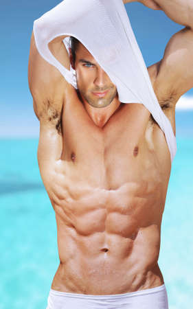 Photo for Vibrant fashion portrait of a sexy muscular fit man - Royalty Free Image