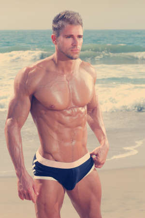 Photo pour Sexy very muscular handsome man in underwear on beach - image libre de droit
