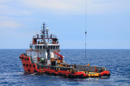 Foto de Crew and Supply Vessel offshore or Supply Boat - Imagen libre de derechos