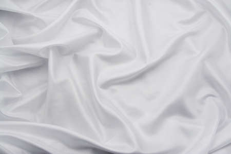 Luxurious white satin/silk folded fabric, useful for backgrounds