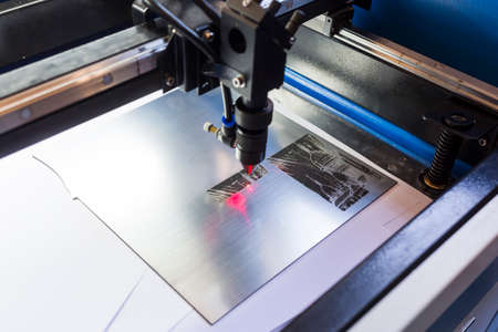 Photo for Laser machine is cutting an image on a flat sheet ot steel in a university laboratory. - Royalty Free Image