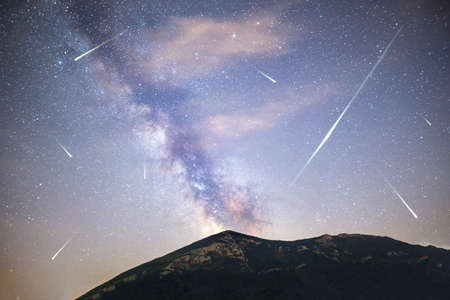Photo pour A view of a Meteor Shower and the Milky Way with a mountain top in the foreground. Night sky nature summer landscape. Perseid Meteor Shower observation. Rtanj mountain in Serbia. - image libre de droit