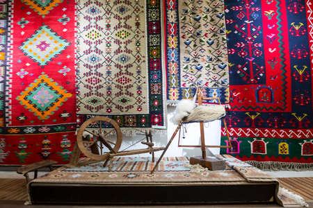 Photo pour Weaving equipment for Chiprovtsi Carpets. Traditional colorful carpets from Chiprovtsi region in Bulgaria. Hand-woven (hand-made) carpets with different elements and colours. Ethnic and folk patterns. - image libre de droit