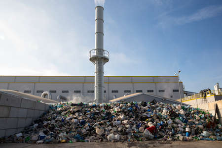 Photo pour Waste-to-energy or energy-from-waste is the process of generating energy in the form of electricity or heat from the primary treatment of waste. Environmentally friendly, environment-friendly. Outside - image libre de droit
