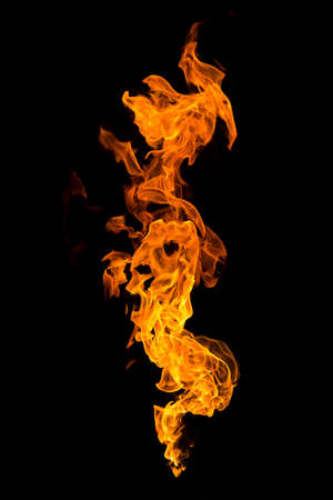 Photo pour Burning flame isolated on a black background. Fire in red, orange and yellow. Vertical orientation image. - image libre de droit