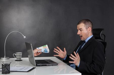Photo pour Businessman earning money on network.  He is receiving euro cash over internet. - image libre de droit