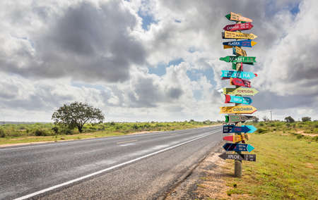 Photo pour Funny different world directions signpost with distance to many different countries - image libre de droit
