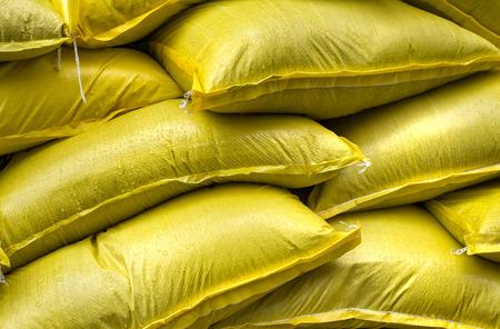 Foto de Industrial Yellow Sacks Stacked - Imagen libre de derechos